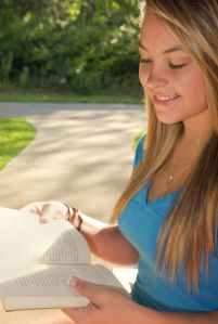 Free Stock Photo: The young woman pictured here was photographed while she was reading a book outdoors in the fresh air, on what appeared to be a beautiful Georgian day.