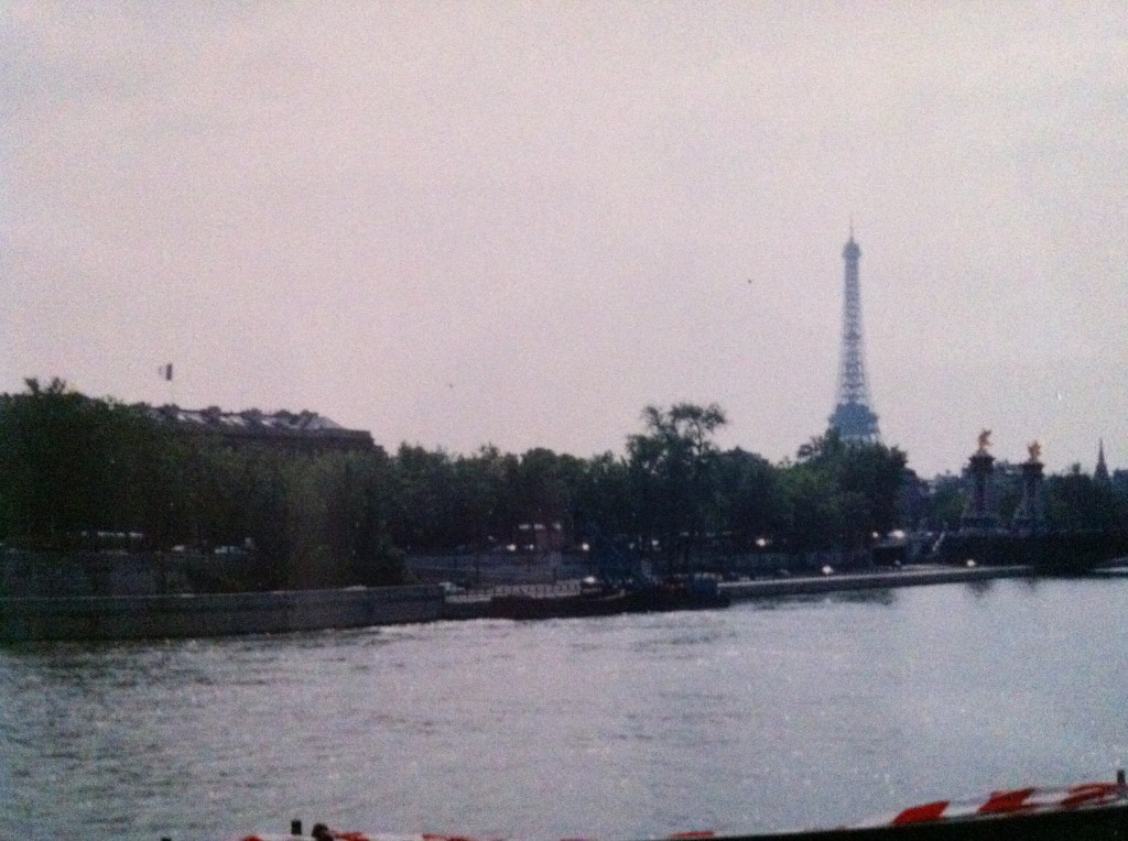 A Paris view. [Very old photo, by me, 1994. Look vaguely familiar? It's on the back cover of Passports.]