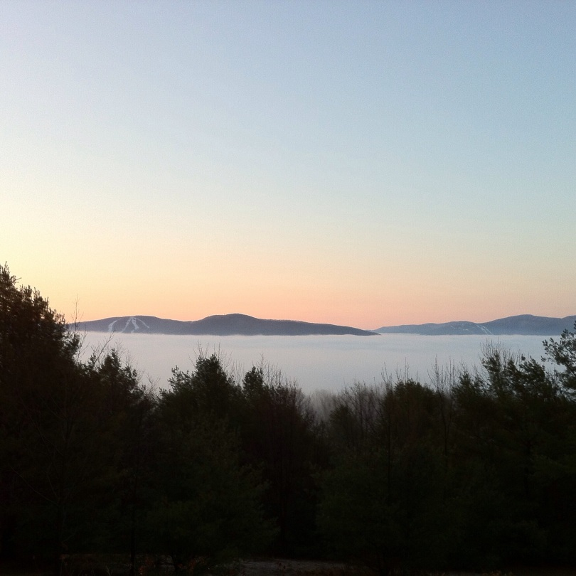 Morning mist below Windham Mountain (left) and Hunter Mountain (distant, right), in the Catskills. [Photo by me, 2014.]