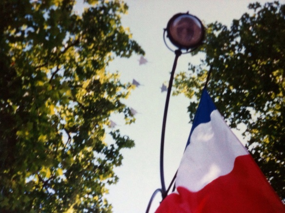 French jets overfly a Bastille Day parade. [Photo by me, 1995.]