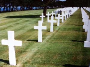 The grave of U.S. Lieutenant General Lesley McNair, in the Normandy American Cemetery and Memorial. McNair was killed in Normandy, July 25, 1944. He was the highest ranking U.S. soldier to die in combat in the Second World War. [Photo by me, 1995.]