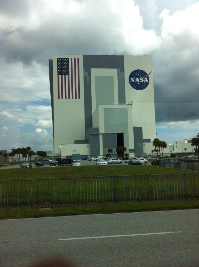 Large Vehicle Assembly Building. Not bad for a photo snapped through a window of a moving tour bus. [Photo by me, 2014.]