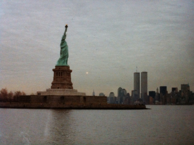 Statue of Liberty and World Trade Center's Twin Towers, from the Liberty Island ferry. [Photo by me, 1991.]