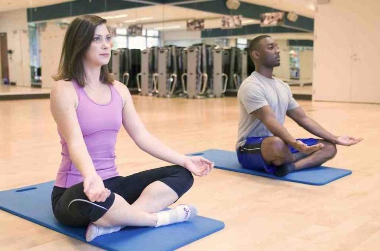Free Stock Photo: A man and woman practicing yoga in a fitness center
