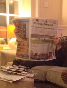 My father-in-law, immersed the other day in Britain's Daily Telegraph. There are still people who read print, day old, news. [Photo by me, 2014.]