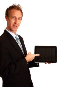 Free Stock Photo: A young businessman holding a tablet computer