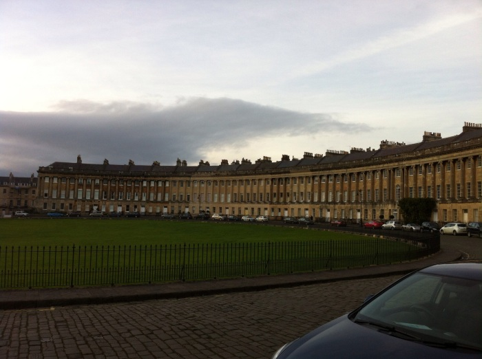 View of part of the Royal Crescent, looking over a corner of Royal Victoria Park. [Photo by me, 2015.]