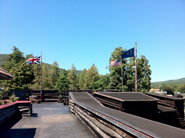 Three countries' flags - the U.S.A., Great Britain and pre-revolutionary France - over Fort William Henry, in upstate New York. [Photo by me, 2013.]