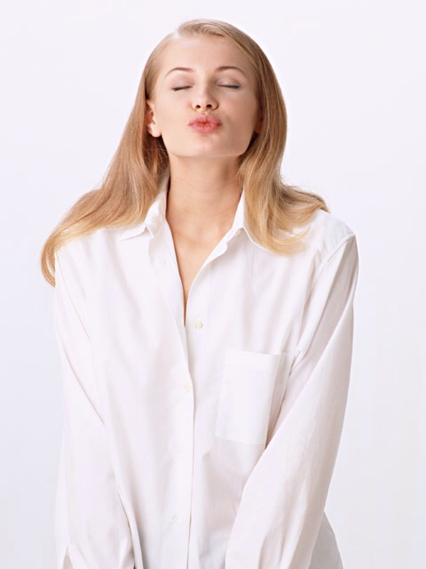 Free Stock Photo: A beautiful blonde puckering for a kiss isolated on a white background. (NOTE: I didn't write that awful caption. That site did.)