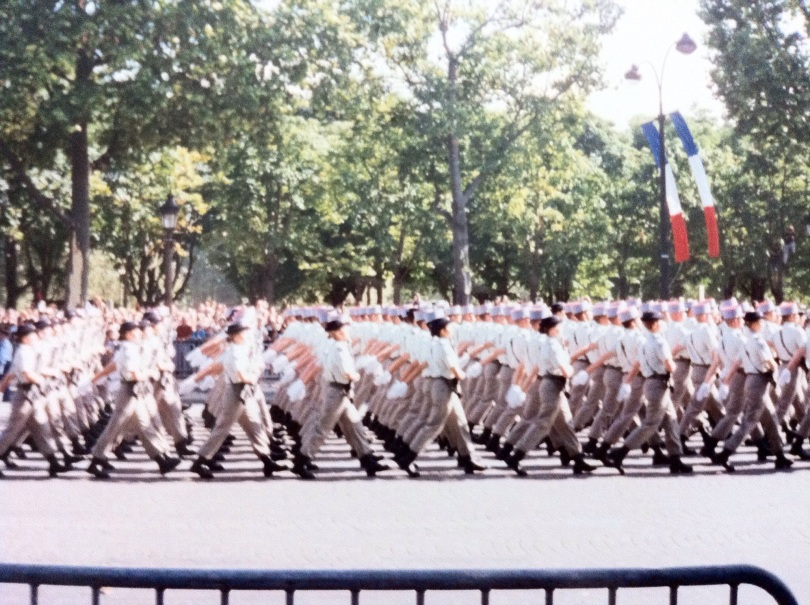 Bastille Day parade, July 1995. There are French women in this unit of (I believe) gendarmes. [Photo by me, 1995.]
