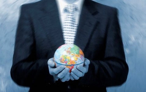 Free Stock Photo: Businessman holding a globe.