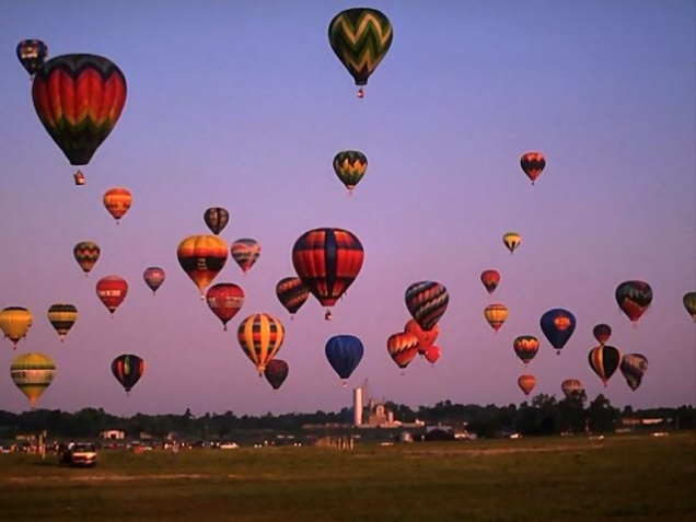 Free Stock Photo: Hot air balloons taking off from a field.