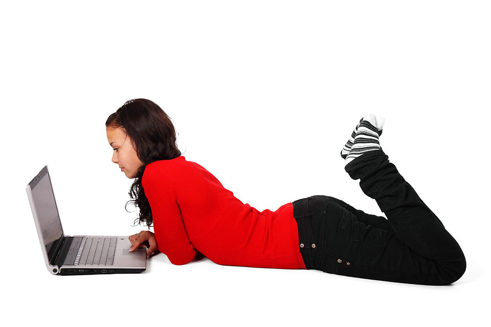 Free Stock Photo: A beautiful girl lying on the floor with a laptop isolated on a white background.