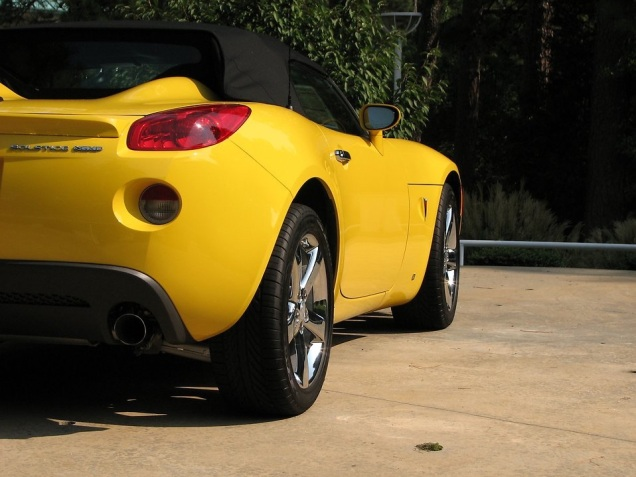 Free Stock Photo: Side view of a yellow sports car.