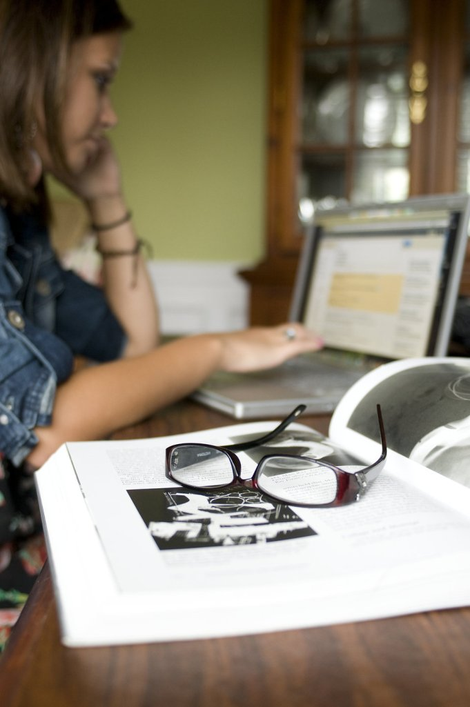 Free Stock Photos: A student on a laptop.