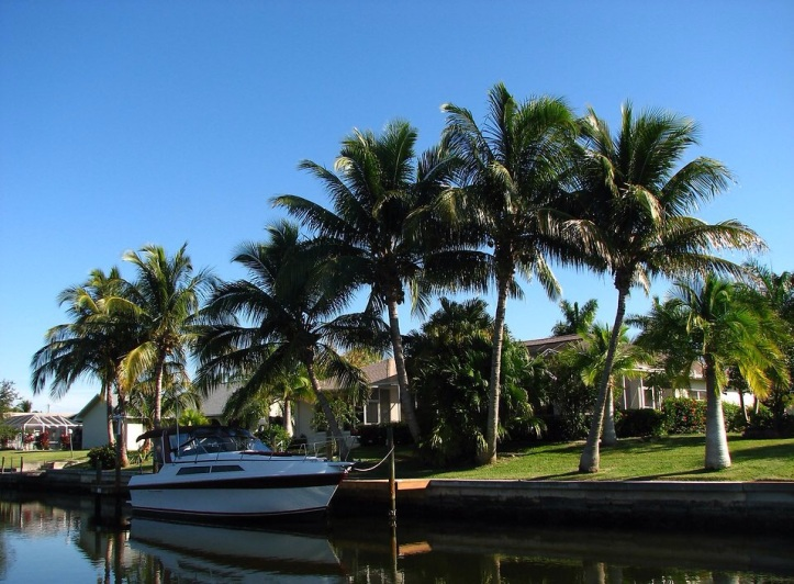 Free Stock Photo: A boat docked by a waterfront house.