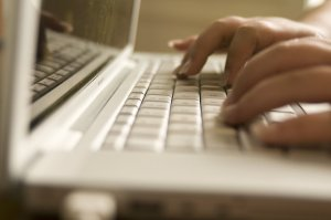 Free Stock Photo: Female hands typing on a laptop keyboard.