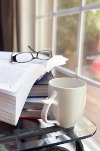 Free Stock Photo: A cup of coffee with a stack of books.