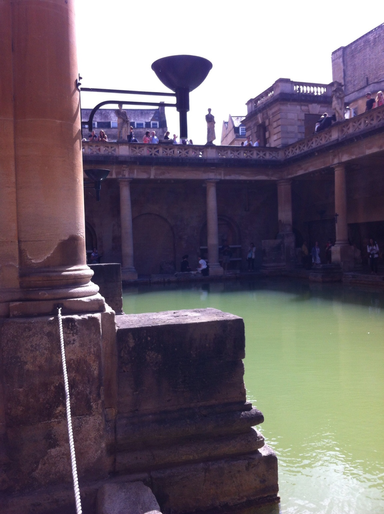 Along the main bath. If you expand the photo, in the center two women employees are dressed up in Roman outfits. [Photo by me, 2015.]