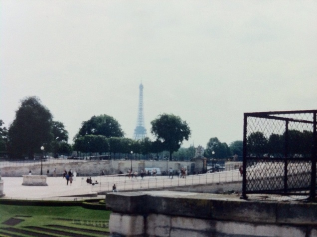 A famous sight, in the distance (although not photographed on exactly July 14). [Photo by me, July 1995.]