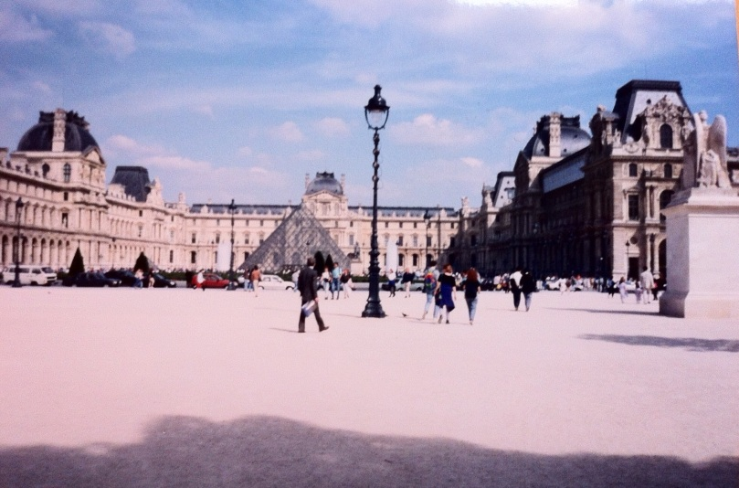 Louvre Pyramid (although not photographed on exactly July 14). [Photo by me, July 1995.]