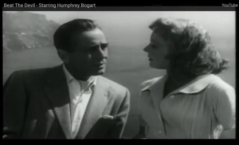 Screen capture of Beat the Devil, with Bogart and Jennifer Jones.