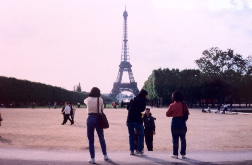 Tourists at the Eiffel Tower. [Photo by me, July 1996.]