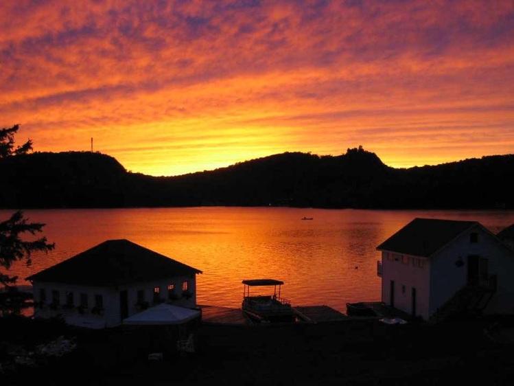 Free Stock Photo: A beautiful sunset over a lake.