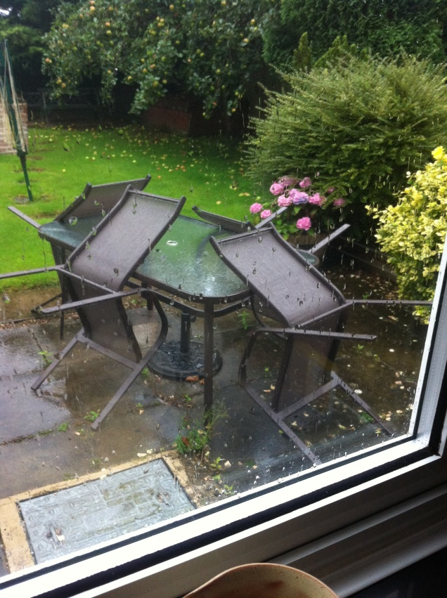 Rained on garden furniture. [Photo by me, this morning.]