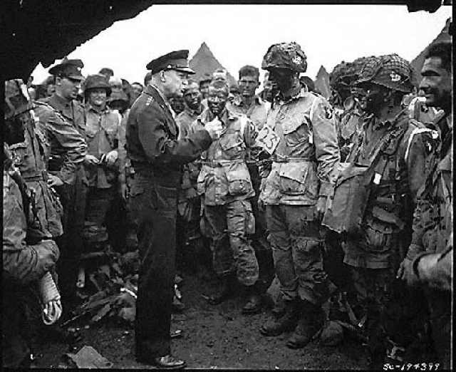 The famous photo: General Eisenhower, visiting U.S. airborne troops on the eve of D-Day. [U.S. army photo.]