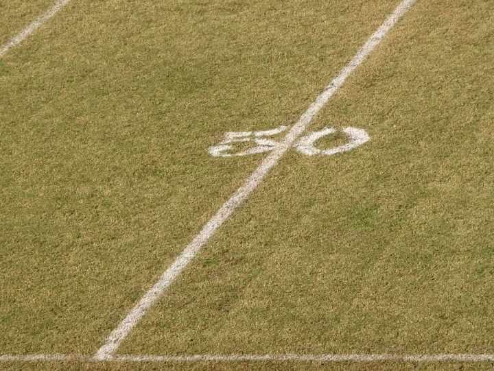 Free Stock Photo: 50 yard line on a football field.