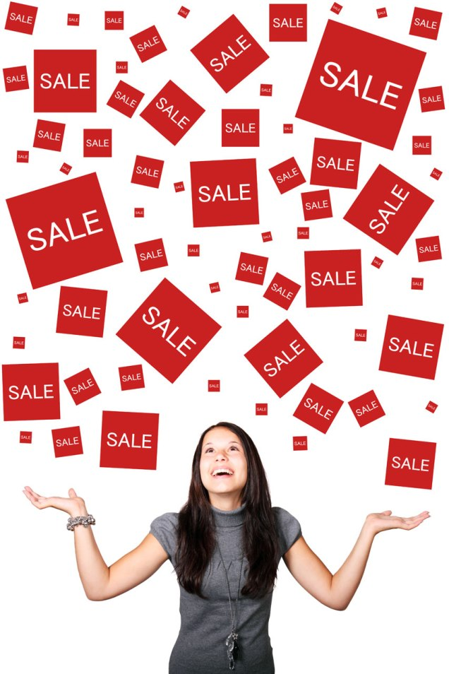 Free Stock Photo: A beautiful girl enjoying sales signs.
