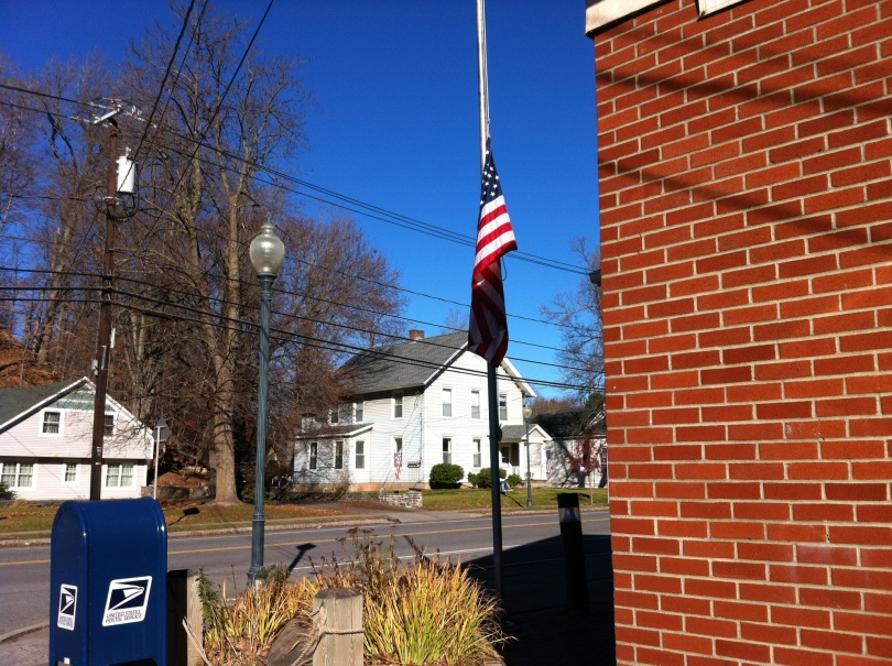 U.S. flag at half-staff outside the post office in Windham, New York, in memory of the victims of the Paris massacres. [Photo by me, 2015.]