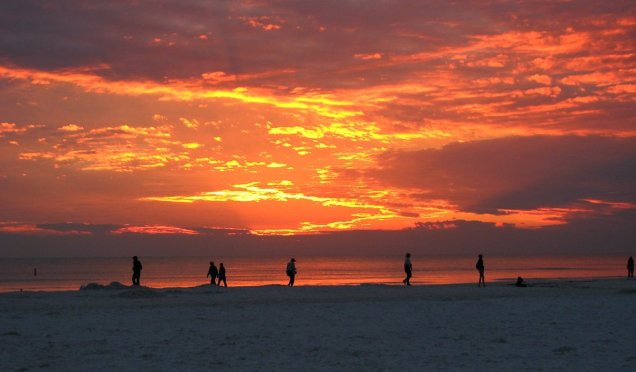 Free Stock Photo: People watching the sunset on the beach.
