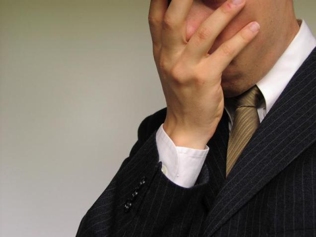 Free Stock Photo: Closeup of business man burying head in hand.