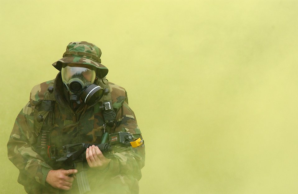 Free Stock Photo: Soldier in gas mask with cloud of smoke.