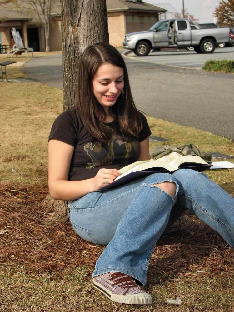 Free Stock Photo:Teenage girl reading a book.