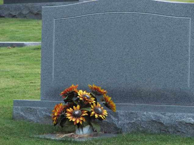 Free Stock Photo: A blank tombstone with flowers.