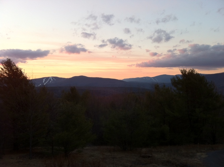 """Windham Mountain ski resort (about 5 miles away), left. Hunter Mountain (about 15 miles away), right. Taken from our house earlier just around sun up. It's nearly all """"artificial"""" snow. [Photo by me, 2016.]"""