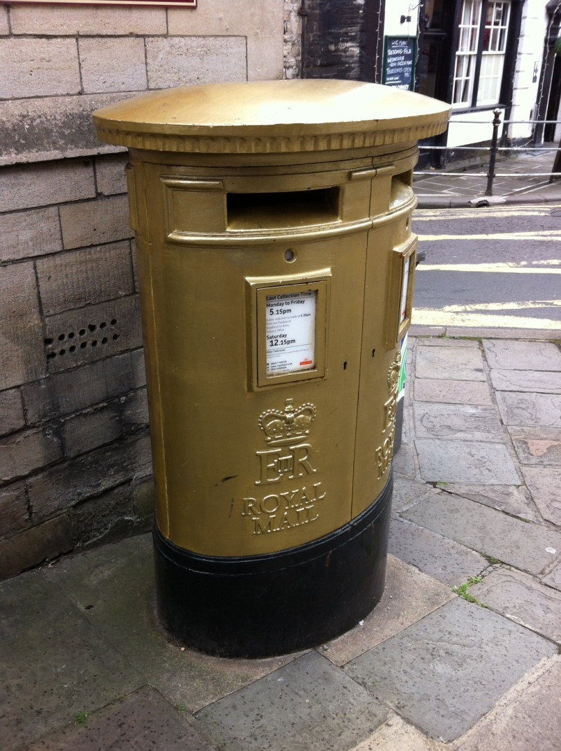 Post Box, Bradford-on-Avon, Wiltshire. Painted gold to mark Ed McKeever's 2012 Gold Medal Men's Canoe Sprint Kayak Single 200m. [Photo by me, 2015.]