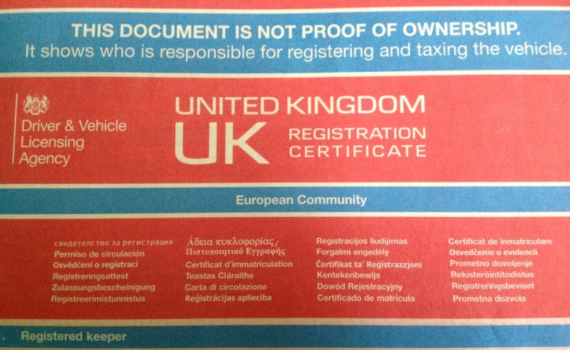 Part of a paper version of a V5C UK car ownership certificate. [Photo by me, 2016.]