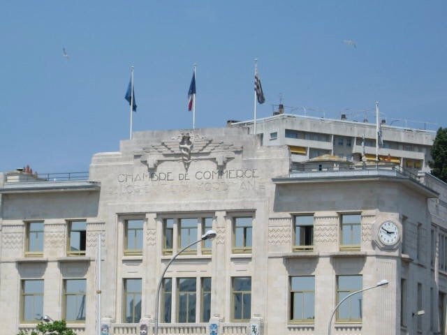 Flag of the European Union, left, flag of the French Republic, middle, and flag of Brittany, right. Lorient, France. [Photo by me, 2010.]