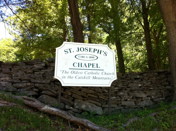 Sign for St. Joseph's Chapel, on Route 23, Ashland, Catskills. [Photo by me, 2016.]