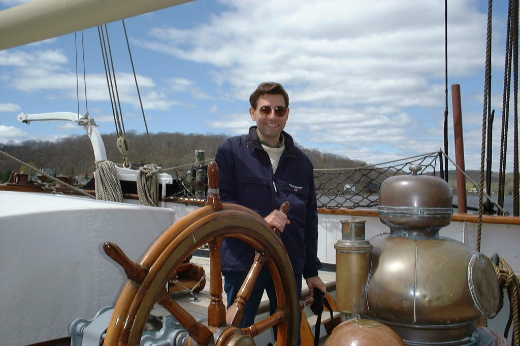 At the helm of the Charles W. Morgan, Mystic, Connecticut, April 2000. [Photo by Mrs. Nello.]