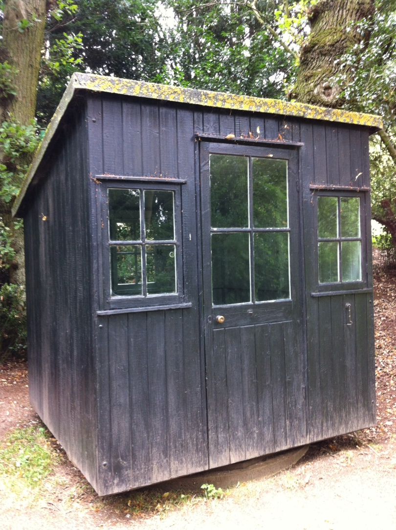 Shaw's writing hut, about the size of a garden shed. [Photo by me, 2016.]
