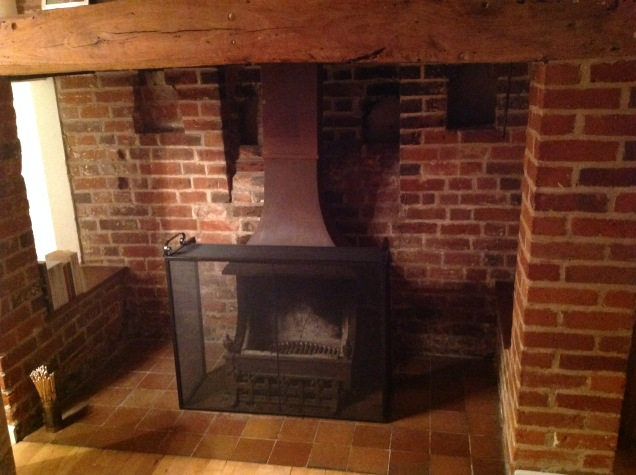 Modernized wood burner inside the cavernous late-1600s fireplace. [Photo by me, 2016.]