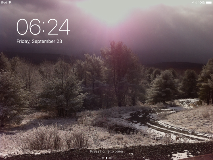 """Screen capture of my iPad """"Locked"""" screen. It's a wintry photo looking down our driveway in the Catskills. [Photo by me.]"""