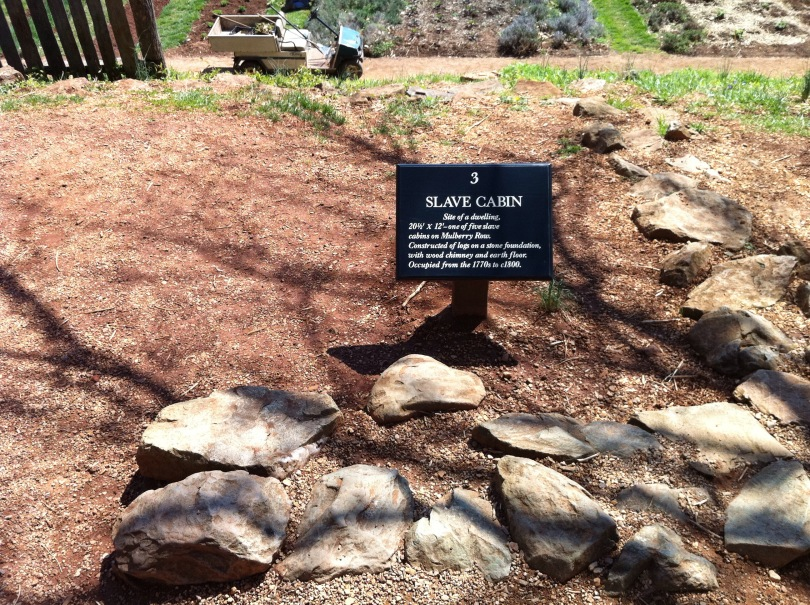 Marker denoting a spot down the hill away from the main house, where a slave cabin had once stood. [Photo by me, 2011.]